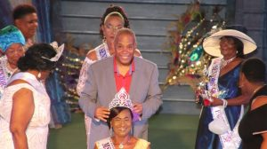 Hon. Eric Evelyn, Minister responsible for senior citizens on Nevis crowns Ms. Idella Wallace of Stoney Grove, as the new Miss Nevis Senior Queen, a pageant hosted by the Ministry of Social Development through the Department of Social Services, Senior Citizens Division at the Cultural Village, on October 25, 2019