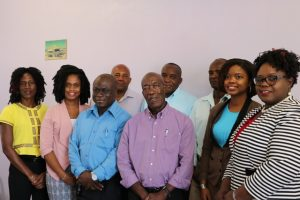 Hon. Hazel Brandy, Junior Minister of Health (front row extreme right) with members of the new Board of Directors at the Nevis Solid Waste Management Authority at the installation ceremony on October 14, 2019, at the Ministry of Communication's conference room at the Nevis Island Administration's office in Charlestown. Front row (l-r): Mrs. Shelisa Martin-Clarke, Acting Permanent Secretary in the Ministry of Health and Gender Affairs; Ms. Latoya Jeffers, Ministry of Education; Mr. Andrew Hendrickson, Manager of the Nevis Solid Waste Management Authority; Mr. St. Clair Wallace as the Chairman of the Board; Mrs. Kimberly Hanley-Bello of the Legal Department. (Back row l-r) Mr. Rudy Browne Operations Manager at the Nevis Solid Waste Management Authority; Mr. Oscar Browne, Community Activist; Mr. Anthony Webbe formerly of the Department of Environmental Health. Absent is Ms. Camille Kelly, Architect