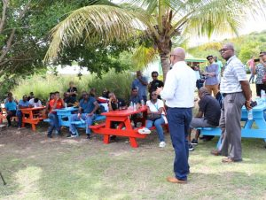 Hon. Spencer Brand, Minister of Water Services on Nevis, welcoming some delegates of the Caribbean Water and Wastewater Association conference in St. Kitts at the Nevisian Heritage Village, during a tour on October 18, 2019. He was accompanied by Dr. Ernie Stapleton, Permanent Secretary in the Ministry responsible for Water Services in the Nevis Island Administration
