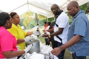 Some delegates of the Caribbean Water and Wastewater Association conference in St. Kitts, sampling local cuisine at the Nevisian Heritage Village in Gingerland during a tour to Nevis on October 18, 2019