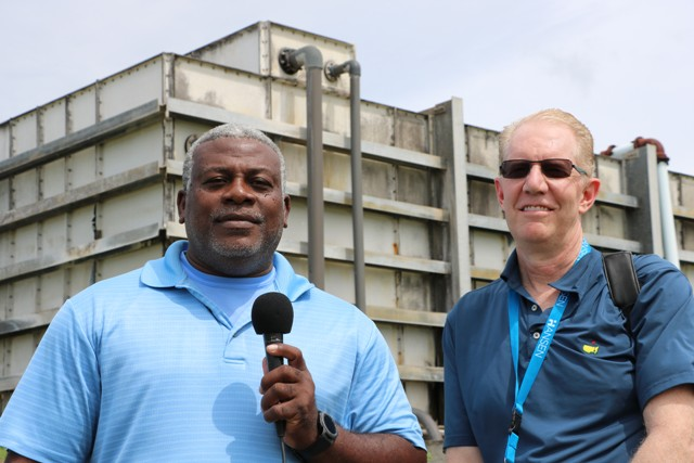 (l-r) Mr. Floyd Robinson, Manager of the Water Resource Management Department in the Ministry of Communications and Project Manager for the installation of a filtration system at Hamilton; and Mr. Greg Gilles, Vice President of AdEdge Water Technologies; on site at Hamilton on October 18, 2019, where the water filtration system will be installed