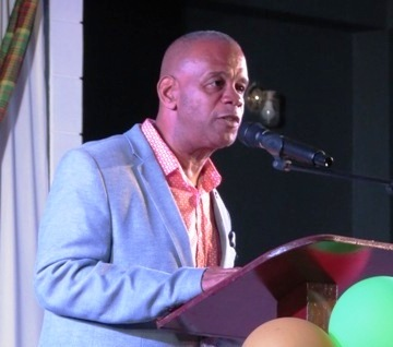 Hon. Eric Evelyn, Minister of Social Development and Culture delivering remarks at the official opening and naming of the first multi-purpose facility in Gingerland on November 28, 2019