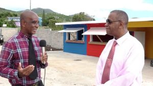 (L-r) Mr. Sterling Heyliger of Gingerland with Hon. Eric Evelyn, Minister of Social Development and Area Representative for the St. George's Parish at the multi-purpose facility at Gingerland on November 25, 2019