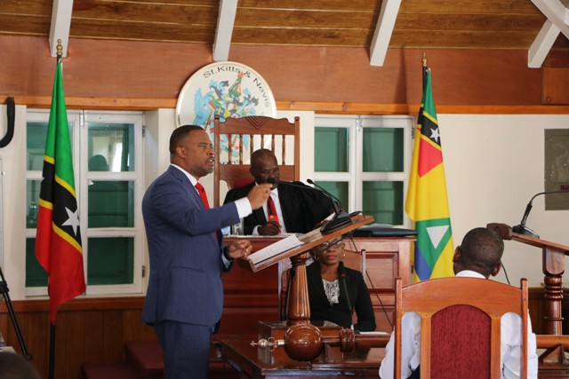 Hon. Mark Brantley, Premier of Nevis and Minister of Finance in the Nevis Island Administration, makes his presentation at a sitting of the Nevis Island Assembly before Hon. Farrel Smithen, President of the Nevis Island Assembly and Ms. Myra Williams, Clerk on November 19, 2019