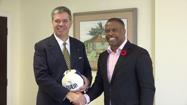 Hon. (l-r) His Excellency Mr. Massimo Ambrosetti, Italian Ambassador to St. Kitts and Nevis presents Hon. Mark Brantley, Minister of Foreign Affairs and Premier of Nevis with footballs from the National Soccer Federation in Italy, at Mr. Brantley's office at Pinney's Estate on November 06, 2019