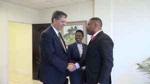 (l-r) Hon. Mark Brantley, Minister of Foreign Affairs and Premier of Nevis, welcomes His Excellency Mr. Massimo Ambrosetti, Italian Ambassador to St. Kitts and Nevis to his office at Pinney's Estate on November 06, 2019. Ms. Thouvia France, Foreign Service Officer in the Ministry of Foreign Affairs looks on