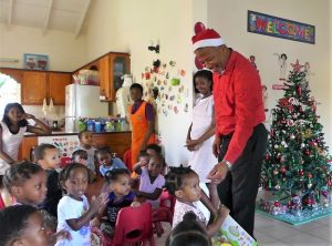 Hon. Spencer Brand, Area Representative for the St. Paul's Parish with Ms. Oneka Fortune, Supervisor of the Steppin' Stone Nursery Phase 1 at Stoney Grove in Charlestown during a recent visit spreading Christmas cheer