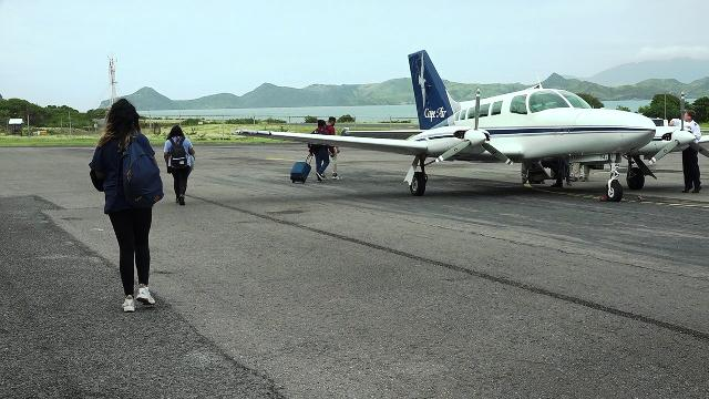 Passengers boarding Cape Air's first flight from the Vance W. International Airport on December 12, 2019