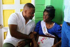 Hon. Mark Brantley, Premier of Nevis presenting a Certificate of Recognition on behalf of the Ministry of Social Development during her 100th birthday celebration at her home in Hamilton on November 30, 2019