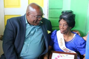 "Photo caption: Hon. Dr. Timothy Harris Prime Minister of St. Kitts and Nevis sharing a light moment with Nevis' newest centenarian Ms. Eliza ""Liza Liburd Jeffers"" Flanders during her birthday celebration at her home in Hamilton on November 30, 2019"
