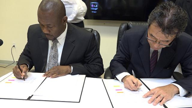 (L-r) Mr. Brian Dyer, Director of the Nevis Disaster Management Department signs Memorandum of Understanding with His Excellency Tatsua Hirayama, Japan Ambassador to St. Kitts and Nevis at the Nevis Disaster Management Department's conference room at Long Point on December 17, 2019, for the Japan Grant Aid Project for Improving Disaster Resilience in Nevis