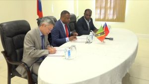 (L-r) His Excellency Tom Lee, Republic of China (Taiwan)'s Resident Ambassador to St. Kitts and Nevis, and Hon. Mark Brantley, Premier of Nevis, signing the Loan Agreement, at Government Headquarters at Pinney's Estate on December 30, 2019, between the Nevis Island Administration and Taiwan International Cooperation and Development Fund in relation to Nevis Small Enterprise Re-lending Project, while Mr. Colin Dore, Permanent Secretary in the Ministry of Finance looks on