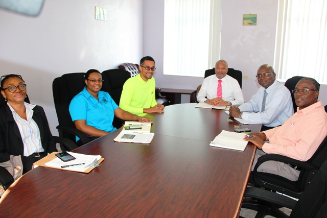 (L-r) Lillith Richards, Project Coordinator from the Project Management Unit; Ms. Annmarie Goulbourne, Senior Environmental Analyst of Environmental Solutions in Jamaica; Mr. Timothy Thwaites of Smith Warner International a Jamaican based engineering firm; Hon. Spencer Brand, Minister of Physical Planning and Environment; Dr. Ernie Stapleton, Permanent Secretary in the Ministry of Physical Planning and Environment; and Denzil Stanley, Principal Assistant Secretary at a meeting at the Nevis Island Administration's conference room in Charlestown on January 14, 2020
