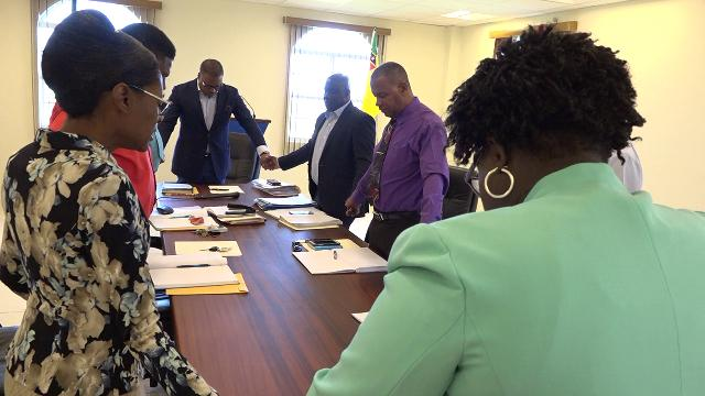 Members of the Nevis Island Administration Cabinet led by Hon. Mark Brantley, Premier of Nevis, in prayer with Rev. Marcia Tomlinson during the first meeting of Cabinet for the year on January 08, 2020