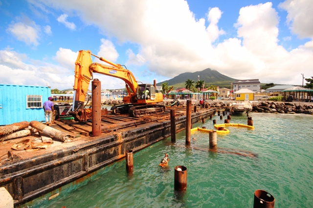 Workers from St. Kitts Marine Works replacing piles for the refurbished tender pier at the Charlestown Port on January 08, 2020