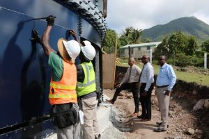 Hon. Spencer Brand, Minister responsible for Water Services; Dr. Ernie Stapleton, Permanent Secretary in the Ministry; and Mr. Denzil Stanley, Principal Assistant Secretary taking a first-hand look at the new storage tank under construction the Hamilton Reservoir site by contractors Florida Aqua Store, during a visit on January 16, 2020