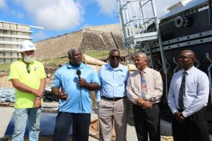 (l-r) Mr. Billy Lightsey, representative for Florida Aqua Store, contractors for the construction of the new water tank at Hamilton; Mr. Floyd Robinson Manager of the Water Resource Management Department on Nevis; Mr. Denzil Stanley, Principal Assistant Secretary in the Ministry of Water Services; Hon. Spencer Brand Minister responsible for Water Services on Nevis; and Dr. Ernie Stapleton; and Permanent Secretary in the Ministry of Water Services visiting the Water Enhancement Project at Hamilton on January 16, 2020