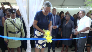 : Her Honour Hyleeta Liburd, Deputy Governor General on Nevis, cuts the ribbon to commission the new building which will house the Nevis Island Administration's Treasury Department on January 30, 2020