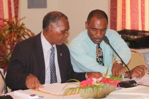 (L-r) Hon. Vance Amory, former Premier of Nevis and Mr. Colin Dore, Permanent Secretary in the Ministry of Finance (file photo)