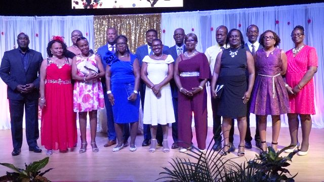 Some of the 16 retirees honoured by the Ministry of Education with Hon. Mark Brantley, Premier of Nevis and Minister of Education (back row - third from left); Hon. Troy Liburd, Junior Minister of Education (back row - fourth from left); Mr. Kevin Barrett, Permanent Secretary in the Ministry of Education (back row – extreme right); Ms. Zhanela Claxton, Principal Education Officer (back row – second from left) and Hon. Alexis Jeffers (back row - extreme left), at the Retirement Awards Ceremony and Cocktail hosted by the Ministry of Education, Library Services and Information Technology at the Nevis Performing Arts Centre at Pinney's estate on February 08, 2020