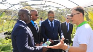 Mr. Vincent Lai, Consultant at the Taiwan Technical Mission in St. Kitts and Nevis who is spearheading the St. Kitts and Nevis Pinney's Beach Park Project at Pinney's Beach, explains the progress of landscaping plants being propagated at a nursery at Cades Bay to (l-r) - Hon. Alexis Jeffers, Deputy Premier and Minister of Agriculture; Hon. Eric Evelyn, Minister of Social Development; Hon. Mark Brantley, Premier of Nevis and His Excellency Tom Lee, the Republic of China (Taiwan) Resident Ambassador to St. Kitts and Nevis on February 13, 2020