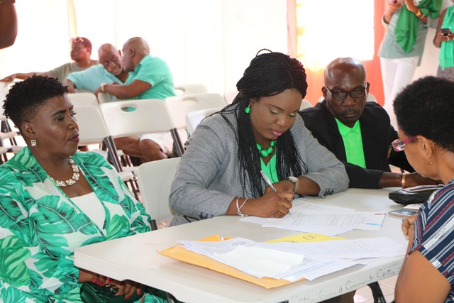 Mrs. Cleone Stapleton Simmonds candidate for the District 5, St. Thomas' Parish by-election signs the Statutory Declaration of a Person Nominated as a Candidate for Election as a Member of the Nevis Island Assembly on Nomination Day, February 25, 2020, at the Cotton Ground Community Centre, before Mrs. Sherilla Nisbett, Returning Officer for the Electoral District 5. She is flanked by her nominators (l) Ms. Jenet Jennifer Jeffers; and (r) Mr. Collin Terrence Stapleton of Cotton Ground
