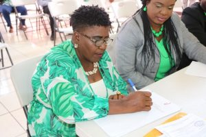 Ms. Jenet Jennifer Jeffers of Cotton Ground signs the Statutory Declaration of a Person Nominating a Candidate for Election as a Member of the Nevis Island Assembly on Nomination Day, February 25, 2020, for Mrs. Cleone Stapleton Simmonds of Cotton Ground (r) the representative for the Nevis Reformation Party, in the March 05, 2020, by-election in District 5, St. Thomas' Parish (Lowlands)