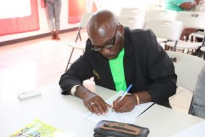 Mr. Collin Terrence Stapleton of Cotton Ground signs the Statutory Declaration of a Person Nominating a Candidate for Election as a Member of the Nevis Island Assembly on Nomination Day, February 25, 2020, for Mrs. Cleone Stapleton Simmonds of Cotton Ground, the representative for the Nevis Reformation Party, in the March 05, 2020, by-election in District 5, St. Thomas' Parish (Lowlands)