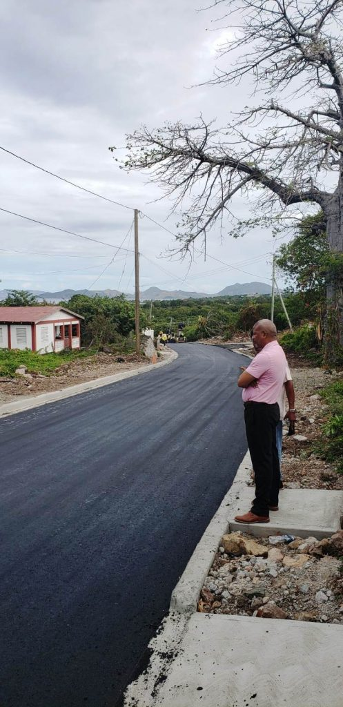 Hon Spencer Brand, Minister of Communication and Work, visits the Craddock Road Rehabilitation Project from Big Rock to the Social Security road junction during the asphalting phase on March 13, 2020
