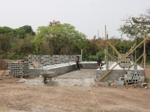 Members of the Building Division in the Public Works Department working on constructing a cold storage facility on the government-owned farm at Prospect on June 22, 2020
