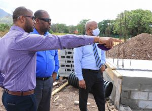 Hon. Spencer Brand, Minister of Communications and Works in the Nevis Island Administration (right), visiting the construction site of a cold storage facility at the government-owned farm at Prospect on June 17, 2020, accompanied by Mr. Alister Thompson Building Supervisor (middle) and Mr. Raoul Pemberton, Director of the Public Works Department on Nevis