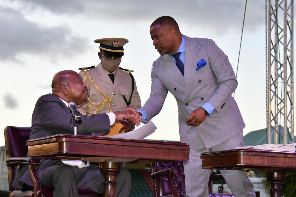Hon. Mark Brantley, Premier of Nevis receives his instruments as Minister of Foreign Affairs and Civil Aviation in the Federal Cabinet from His Excellency Sir Tapley Seaton, Governor General of St. Kitts and Nevis at the Inauguration Ceremony of the Team Unity Administration's Second Term at Warner Park in Basseterre on June 14, 2020