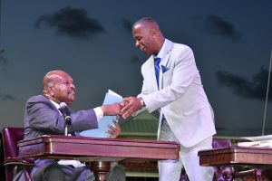 Hon. Eric Evelyn, Senior Minister in the Nevis Island Administration receives his instruments as Minister of Environment and Cooperatives in the Federal Cabinet from His Excellency Sir Tapley Seaton, Governor General of St. Kitts and Nevis at the Inauguration Ceremony of the Team Unity Administration's Second Term at Warner Park in Basseterre on June 14, 2020