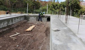 Workmen from the Public Works Department constructing a cold storage facility at the Department of Agriculture's Prospect farm on June 17, 2020