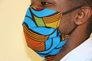 A model shows the side view of a locally made fabric mask