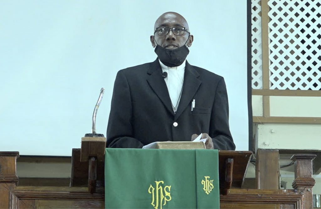 """Rev. Wendell Samuel, Circuit Minister at the Gingerland Methodist Church leads """"United in Christ Giving Thanks and Praise"""" service at the church on July 19, 2020, for the three ministers in the Nevis Island Administration, are no w also ministers in the Government of St. Kitts and Nevis"""