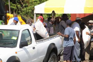 Some of the 154 farmers receiving free animal feed at Prospect on July 15, 2020, as part of a Nevis Island Administration/Eastern Caribbean Group of Companies partnership