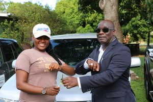 Hon. Alexis Jeffers, Deputy Premier and Minister of Agriculture, hands over the keys to a vehicle to Ms. Shaquinha Hanley, Senior Agricultural Officer in the Department of Agriculture on July 21, 2020, at the Prospect Agricultural Station
