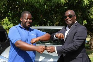 Hon. Alexis Jeffers, Deputy Premier and Minister of Agriculture, hands over the keys to a vehicle to Mr. Kelso Clark, Senior Agricultural Officer in charge of the Livestock Extension Unit in the Department of Agriculture on July 21, 2020, at the Prospect Agricultural Station