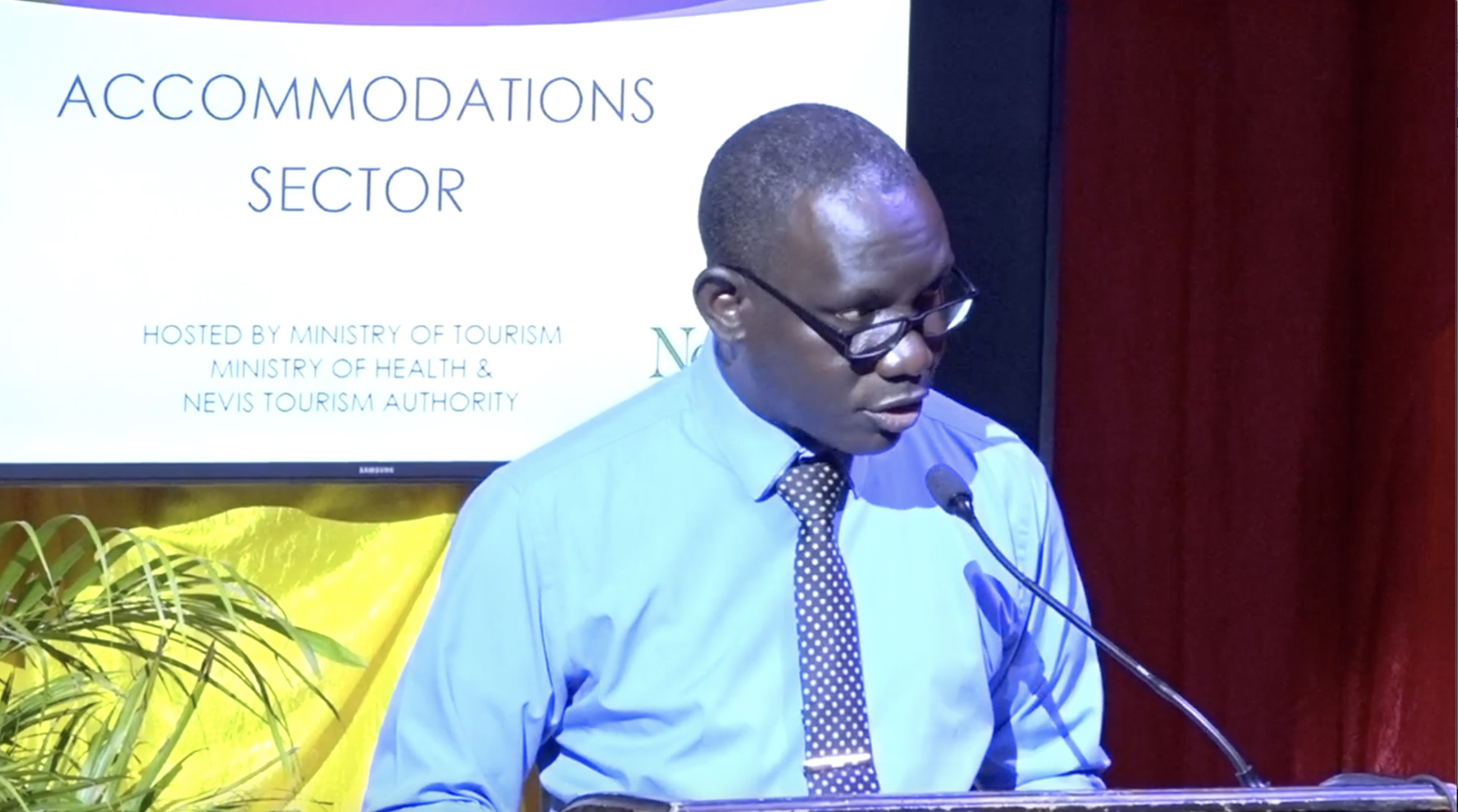 Mr. John Hanley, Permanent Secretary in the Ministry of Tourism on Nevis, delivering remarks at the first COVID-19 sensitization training session, hosted by the Ministry of Tourism in collaboration with the Nevis Tourism Authority and the Ministry of Health, on July 27, 2020 at the Nevis Performing Arts Centre