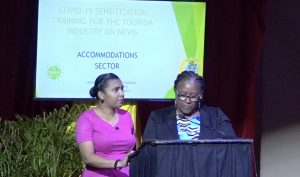 "(L-r)Assistant Nurse Manager Chandreka Wallace; and Assistant Matron Jessica Scarborough from the Alexandra Hospital making a presentation on ""Health and Safety Protocols"" at the first COVID-19 sensitization training session, hosted by the Ministry of Tourism in collaboration with the Nevis Tourism Authority and the Ministry of Health, on July 27, 2020 at the Nevis Performing Arts Centre"