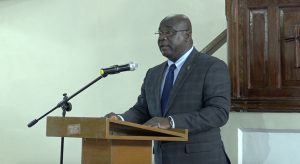 """Hon. Alexis Jeffers, Deputy Premier of Nevis, and Federal Minister of Agriculture and Marine Resources reading a scripture at a """"United in Christ, Giving Thanks and Praise"""" church service at the Gingerland Methodist Church on July 19, 2020"""