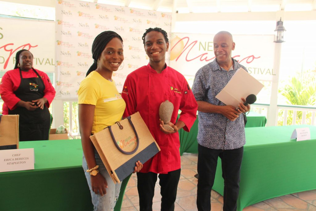 (l-R) Ms. Jadine Yarde, Chief Executive Officer at the Nevis Tourism Authority with Chef Wentworth Smithen, winner of the Cook-Off at the Nevis Mango and Food Festival hosted by the Nevis Tourism Authority at Cleveland Gardens on July 04, 2020. Hon. Eric Evelyn, who served as the master of ceremony, and runner-up chef and culinary artist Erika Stapleton look on