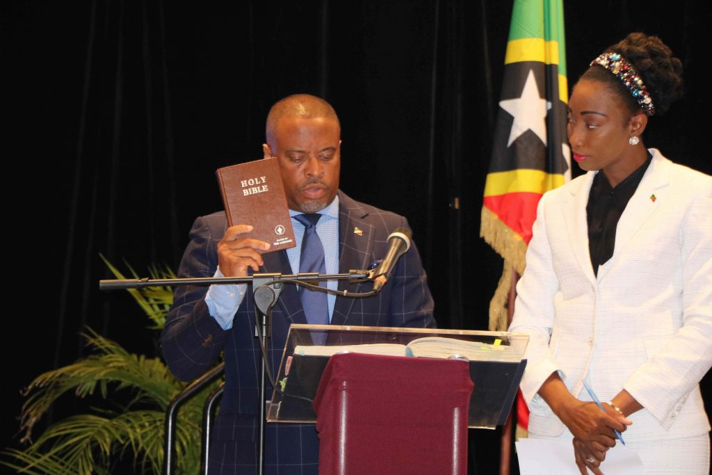 Hon. Mark Brantley, Member for Nevis 9 in the National Assembly, taking the Oath of Allegiance at the Opening of the National Assembly at the St. Kitts Marriott Resort on July 08, 2020, while Mrs. Sonia Boddie-Thompson, Clerk of the National Assembly looks on