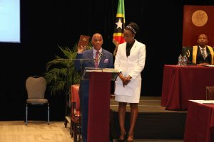 Hon. Eric Evelyn, Member for Nevis 10 in the National Assembly, taking the Oath of Allegiance at the Opening of the National Assembly at the St. Kitts Marriott Resort on July 08, 2020, while Mrs. Sonia Boddie-Thompson, Clerk of the National Assembly looks on