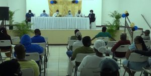Community residents look on as ministers in the Nevis Island Administration make presentations at a recent town hall meeting (l-r) Hon. Troy Liburd; Hon. Alexis Jeffers, Deputy Premier; Hon. Mark Brantley, Premier of Nevis; Hon. Eric Evelyn; Hon. Spencer Brand; and Hon. Hazel Brandy-Williams