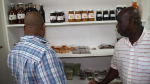 Mr. Ron Dublin-Collins, Permanent Secretary in the Ministry of Agriculture in St. Kitts (left) and Hon. Alexis Jeffers Minister of Agriculture on Nevis and Federal Minister of Agriculture looking at some of the products produced by the Agro Processing Unit in the Department of Agriculture during a tour on July, 28, 2020