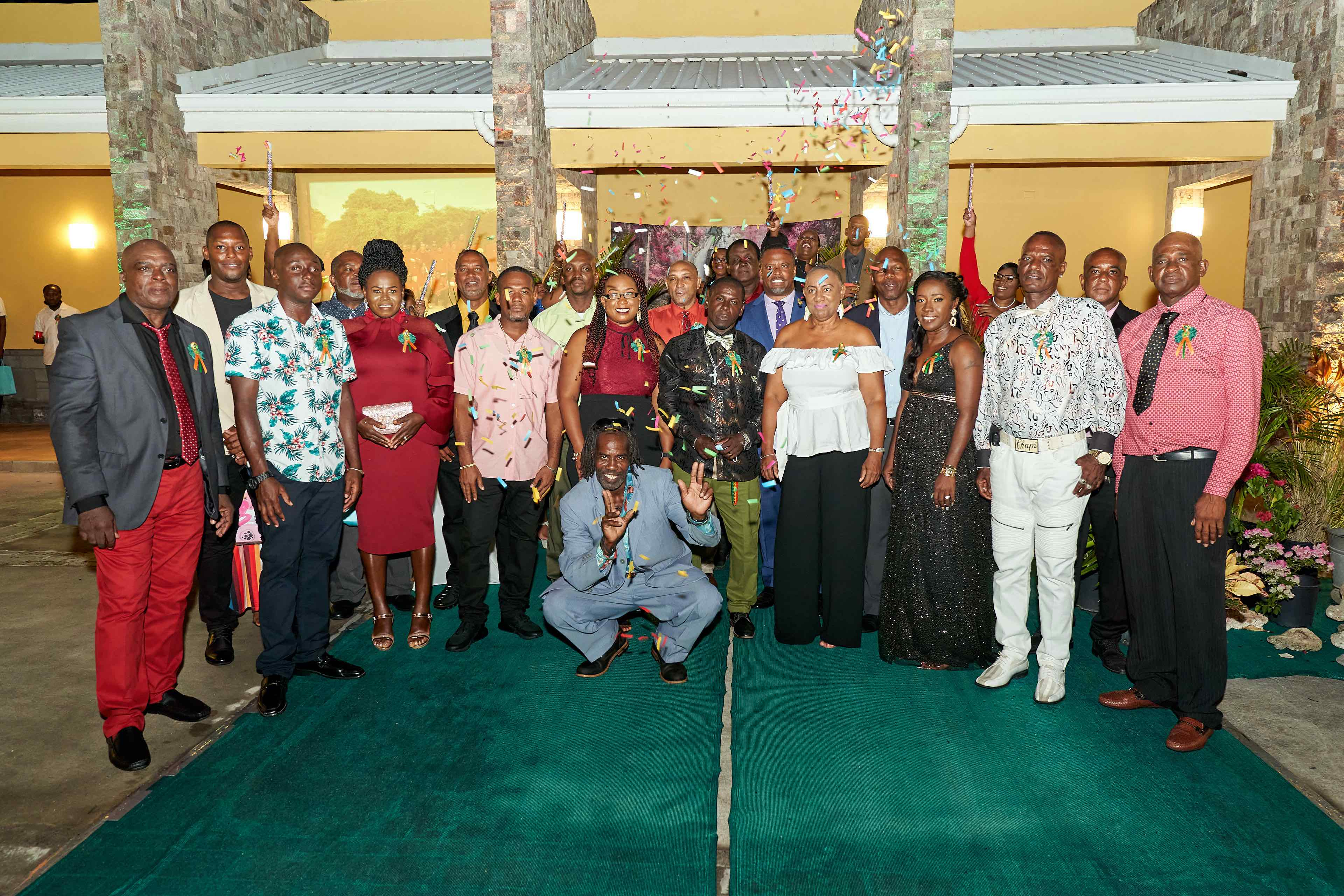 Hon. Mark Brantley, Premier of Nevis and Minister of Public Utilities (second row third from right) with the 25 past and present employees at the Nevis Electricity Company Limited honoured for 20 years of service during the company's cocktail and awards ceremony at the Nevis Performing Arts Centre on August 29, 2020, in celebration of the company's 20th anniversary on September 01, 2020 (Photo courtesy the Nevis Electricity Company Limited)