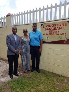 Hon. Eric Evelyn, Minister of Sports, Youth and Community Development in the NIA; with Mildred Sargeant, wife of Livingstone Sargeant; and Tavo Sargeant, son of Livingston Sargeant; at the new cricket practice facility