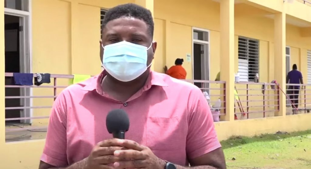 Hon. Troy Liburd, Junior Minister of Education in the Nevis Island Administration, takes a first-hand look at the deep cleaning and sanitizing of the Charlestown Secondary School on August 21, 2020